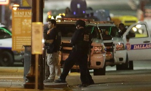 Law enforcement sweep the area after two snipers opened fire on police officers during protests in Dallas.