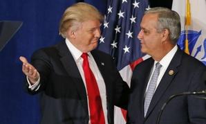 Rep. Jeff Miller, R-Fla., (right) introduces Republican Presidential candidate Donald Trump before a speech in Virginia Beach, Va.
