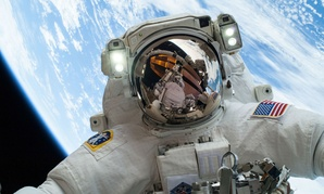 NASA astronaut Mike Hopkins participates in the second of two spacewalks to change out a faulty water pump on the International Space Station in 2014.