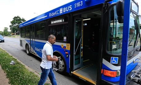 Syrian refugee Ahmad Alabood gets on a bus following English class at Della Lamb Community Services in Kansas City, Mo. in June.
