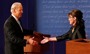 Joe Biden and Sarah Palin green each other before they debate in 2008.