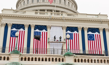 Government employees hang bunting at the U.S. Capitol before the 2009 inauguration.
