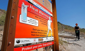 A sign at Piestewa Peak in Phoenix warns hikers of heat exposure in June.