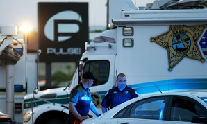 Law enforcement officials stand outside the Pulse nightclub in Orlando, Fla., following the June mass shooting there. Forty-four percent of poll respondents said Trump would be more effective at preventing future attacks, and 41 percent picked Clinton.