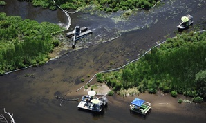 Cleanup work on the Kalamazoo River almost a year after a spill near Marshall, Mich.