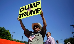 A protestor holds a sign in Texas July 17.