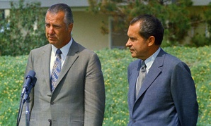 Spiro Agnew and Richard Nixon address the press in 1970.