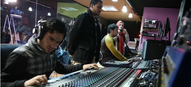 Tolo TV staffers work in the control room of their office in Kabul, Afghanistan.