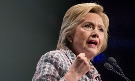 Clinton delivers a speech at the Veterans of Foreign Wars convention.