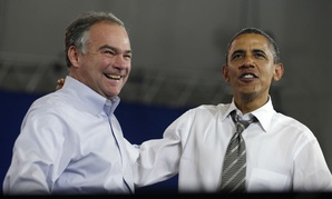 Tim Kaine (left) joins President Obama at a campaign event in 2012.