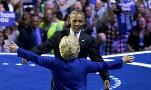 Obama says he is confident in passing the baton to Hillary Clinton.