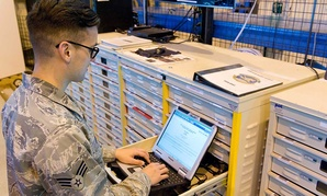 Senior Airman Bryon Grimco works on a laptop in March.
