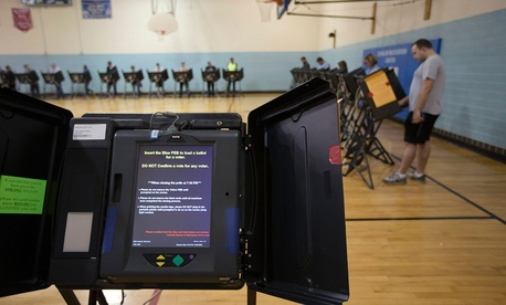 A electronic voting machine waits to be used at the Schiller Recreation Center polling station on election day in 2015.