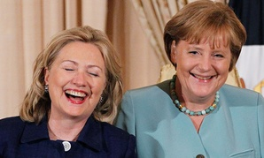 Hillary Clinton and German Chancellor Angela Merkel laugh during a State Luncheon in honor of the German chancellor at the State Department in 2011.