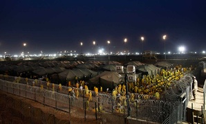 Detainees pray at U.S. military detention facility Camp Bucca, Iraq, in 2009.