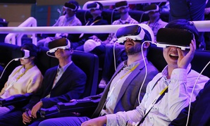 People react as they wear Samsung Gear VR goggles at CES International in Las Vegas.