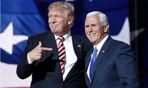 Republican presidential nominee Donald Trump (left) joins vice presidential nominee Mike Pence after Pence's acceptance speech.
