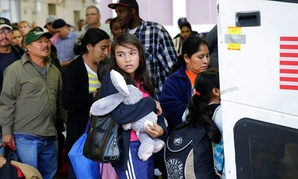 Immigrants from El Salvador and Guatemala, who entered the country illegally, board a bus after they were released from a family detention center in San Antonio in 2015.