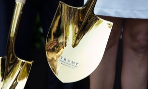 A shovel with the Tump logo is sheen during a ground breaking ceremony for the Trump International Hotel on the site of the Old Post Office in 2014.