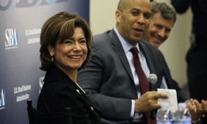 SBA Administrator Maria Contreras-Sweet listens to audience questions during an event with Sen. Cory Booker and Princeton University Professor Alan B. Krueger, right, at the Rutgers Business School in 2015.