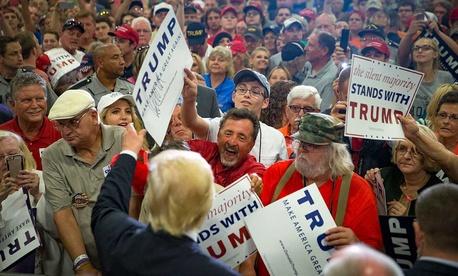 Trump signs autographs at a July rally in Cincinnati.