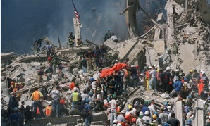Emergency personnel carry an orange body bag with the remains of a victim, two days after the terrorist attacks on the World Trade Center in New York on Sept. 11, 2001.