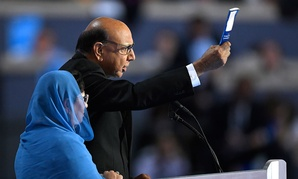 Khizr Khan, father of fallen US Army Capt. Humayun S. M. Khan, holds up his copy the United State Constitution at the Democratic National Convention.