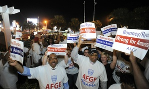 Members of the American Federation of Government Employees protest the GOP presidential ticket in 2012 in Daytona Beach, Fla.