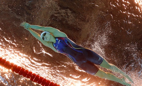 Katie Ledecky swims during a women's 800-meter freestyle heat during swimming competitions at the 2016 Summer Olympics in Rio de Janeiro Thursday.