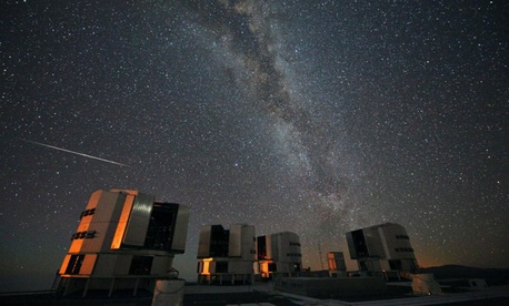 A Perseid seen in August 2010 above the four enclosures of the European Southern Observatory's Very Large Telescope at Paranal, Chile.