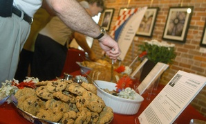 A plate of chocolate chip cookies, made from Hillary Clinton's recipe, is surrounded by food made from recipes from various family and friends of Clinton and former President Bill Clinton, in 2003.