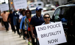 Protestors demonstrate outside the State Attorney's office calling for the continued investigation into the death of Freddie Gray in 2015.