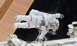 Scott Kelly participates in a space walk at the International Space Station in 2015.