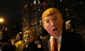 Halloween revelers wear Clinton and Trump masks in New York in 2015.