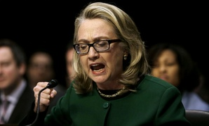 Hillary Clinton testifies on Capitol Hill in January 2013 on the Benghazi attacks, wearing special post-concussion glasses.