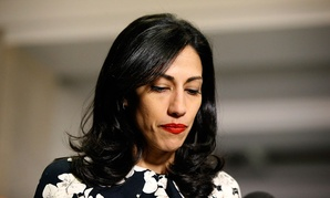 Huma Abedin pauses while speaking to the media after testifying at a closed-door hearing of the House Benghazi Committee in 2015.