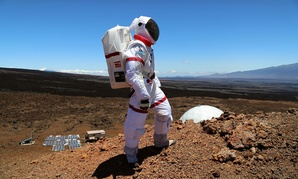 A HI-SEAS crew member from a previous mission explores 'Mars' in Hawaii.