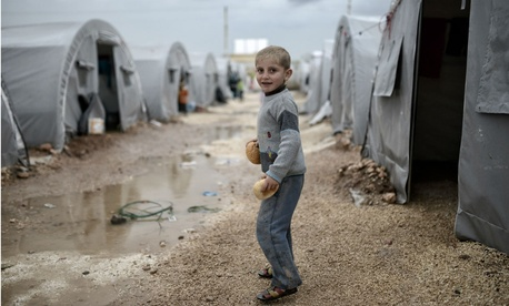 A Syrian boy in a refugee camp in Suruc, Turkey, in October 2015.