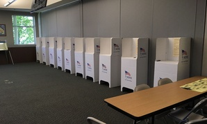 Voting booths are prepared in anticipation of Idaho's May primary in Boise.