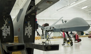 An MQ-9 Reaper sits in a hangar prior to having the wings put on at Holloman Air Force Base in 2015.