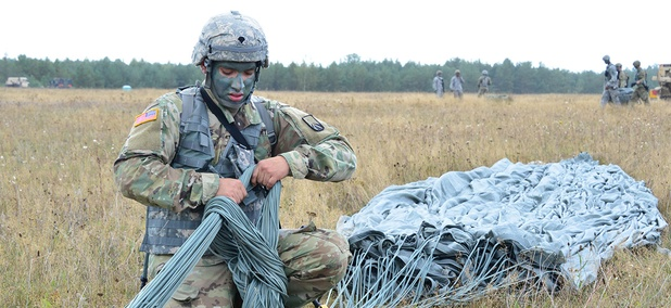 A U.S. Paratrooper recovers a parachute after airborne operation at 7th Army Training Command's Grafenwoehr Training Area, Germany on Sept. 9.