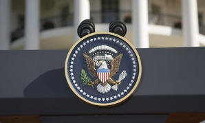 The Presidential Seal on a podium in front of the South Portico of the White House.