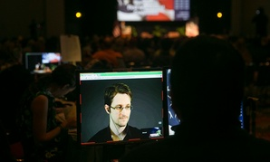 A video technician monitors a computer screen as National Security Agency leaker Edward Snowden appears on a live video feed broadcast from Moscow to Hawaii in 2015.