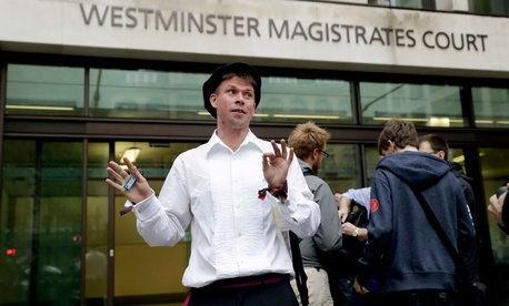 Lauri Love, who is accused of hacking into U.S. government computers, waits outside Westminster Magistrates' Court before the ruling that he should be extradited Friday.