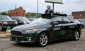 A self-driving Uber car drives in Pittsburgh on Sept. 14.
