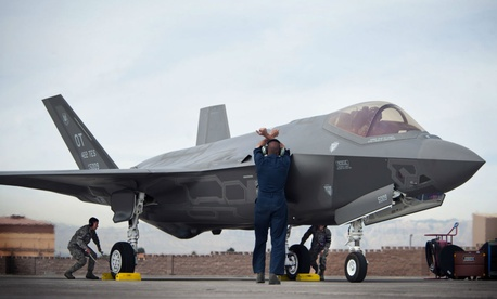 Crew chiefs from the 57th Wing Lightning Aircraft Maintenance Unit prepare an F-35A Lighting II for a training mission at Nellis Air Force Base, Nev.