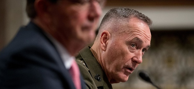 Joint Chiefs Chairman Gen. Joseph Dunford, right, accompanied by Defense Secretary Ash Carter, testifies on Capitol Hill Friday.