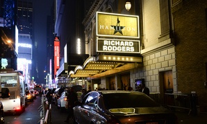 """People walk by the """"Hamilton"""" marquee at the Richard Rogers Theatre on Saturday, July 9, 2016, in New York."""