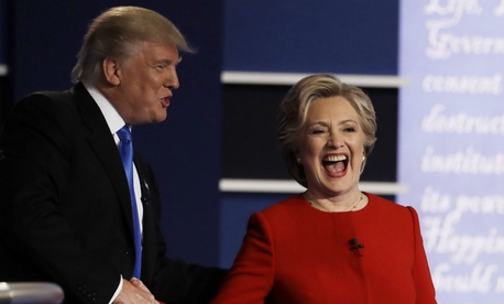 Republican presidential nominee Donald Trump and Democratic nominee Hillary Clinton shake hands after their first debate.