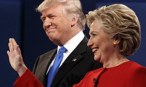 Republican presidential candidate Donald Trump, left, stands with Democratic presidential candidate Hillary Clinton at the first presidential debate at Hofstra University, Monday, Sept. 26, 2016.